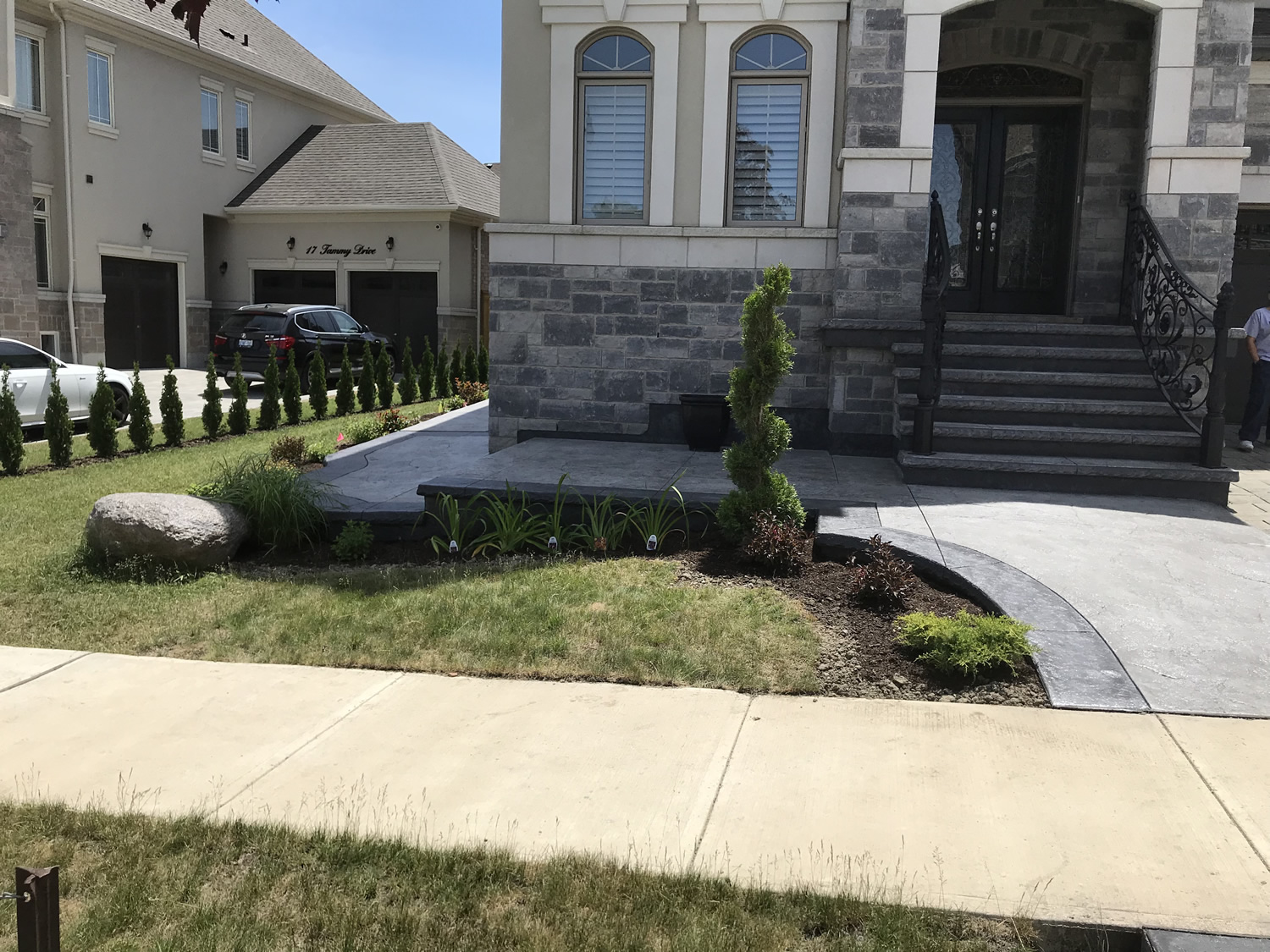 Front After with Cedar Topiary, Shrubs and Perennials
