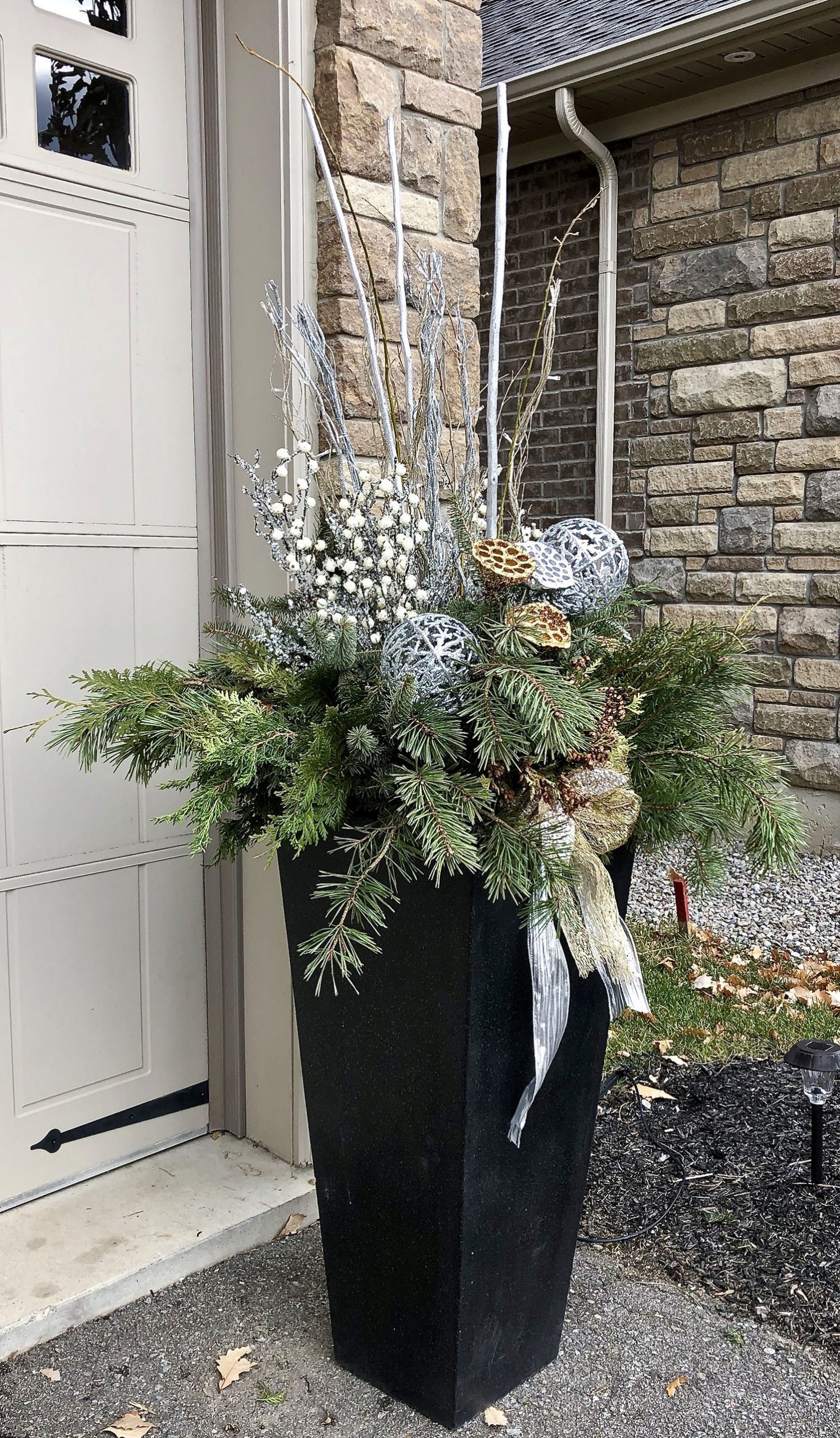 Christmas outdoor planter with silver ribbon