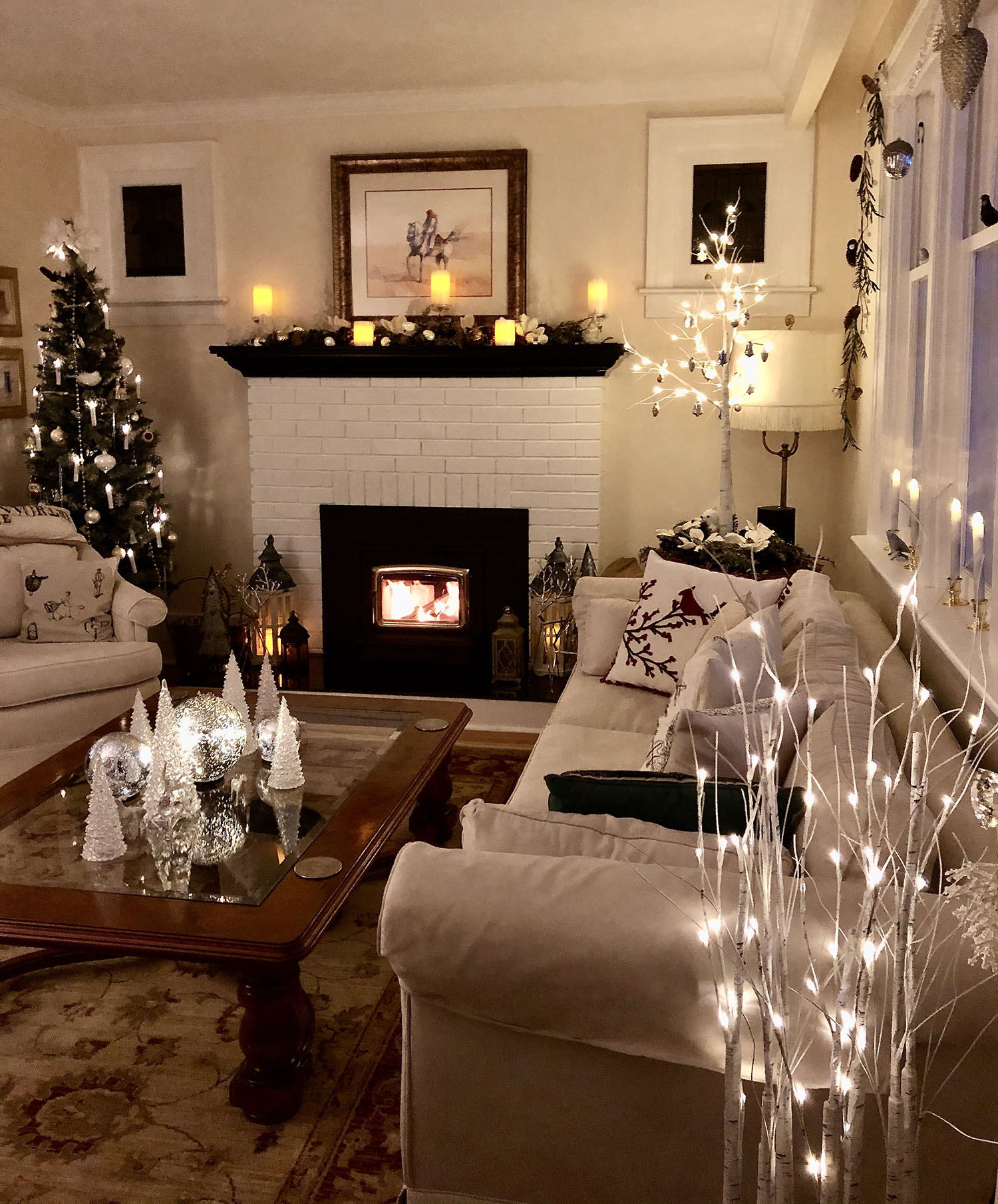 Beautiful Home decorated for Christmas with a Christmas tree, fireplace garland and lights